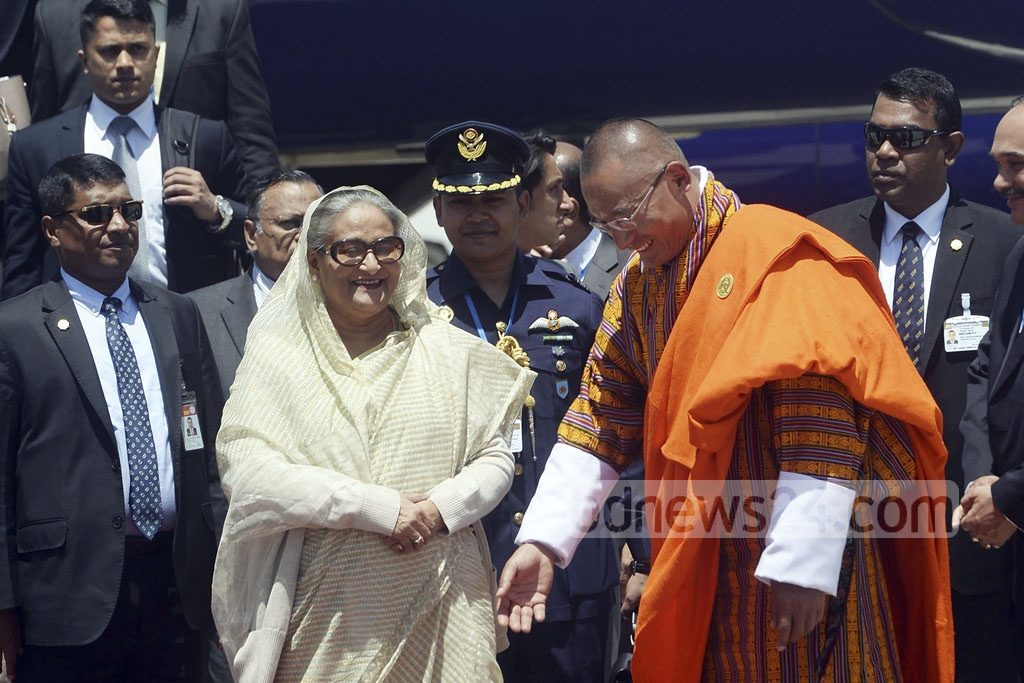 Bhutanese Prime Minister Tshering Tobgay receives Prime Minister Sheikh Hasina at Paro International Airport on Tuesday morning.