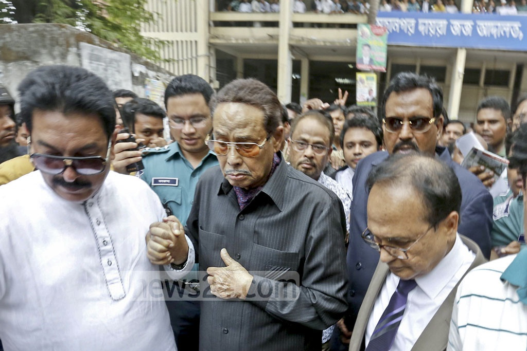Jatiya party chief and former military ruler HM Ershad coming out of the Dhaka Metropolitan Sessions Judge's Court on Wednesday after being acquitted in decades old radar purchase case. 