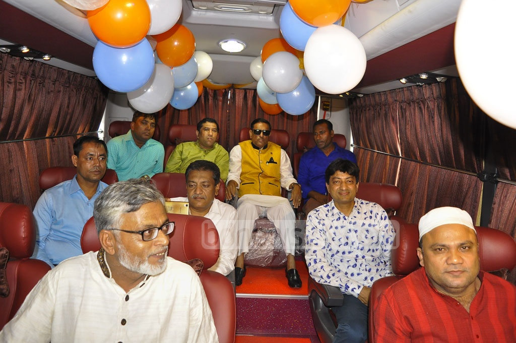 Road Transport Minister Obaidul Quader poses for photos inside a bus of the privately owned Silkline Travels, a service he inaugurated on Wednesday.