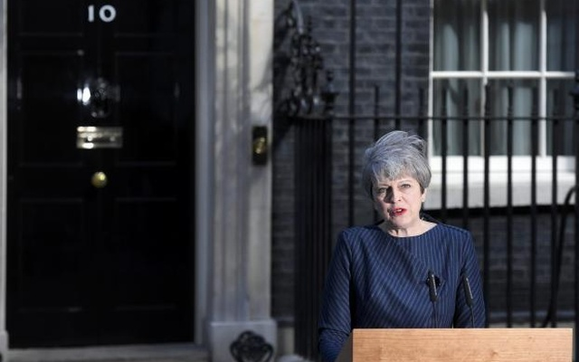 Britain's Prime Minister Theresa May speaks to the media outside 10 Downing Street, in central London, Britain April 18, 2017. Reuters