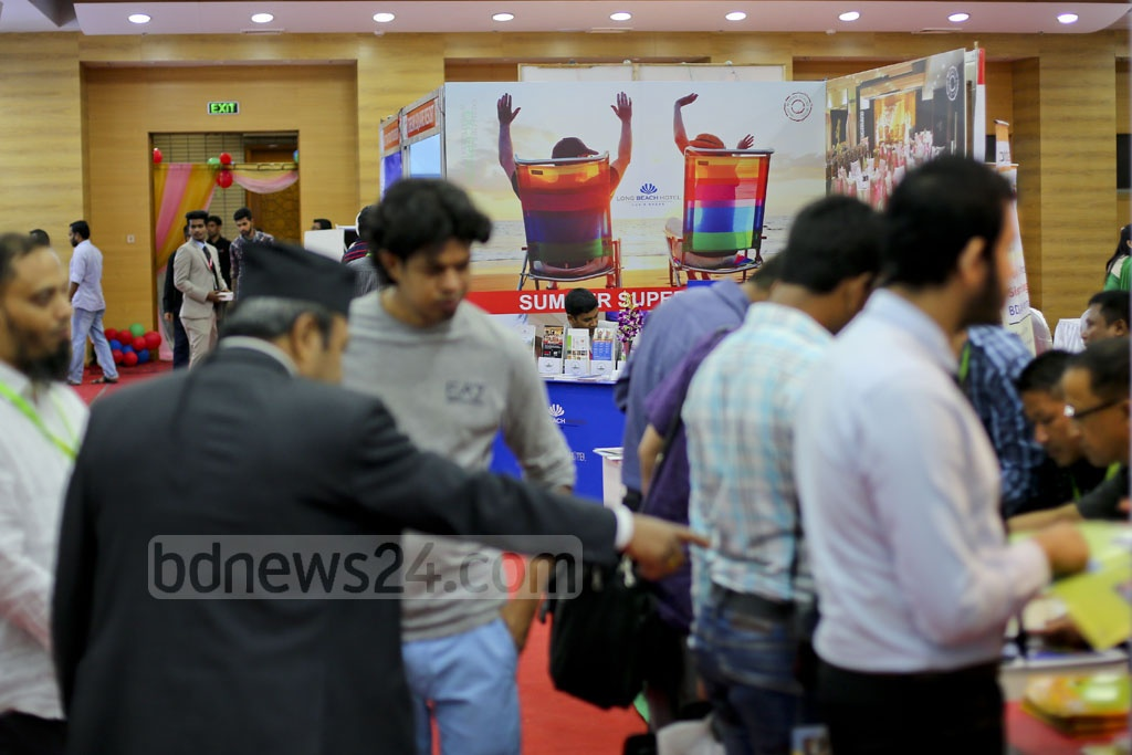 Visitors check what the stalls at Travel and Tourism Fair have for them at Bangabandhu International Fair on Thursday. Photo: asaduzzaman pramanik