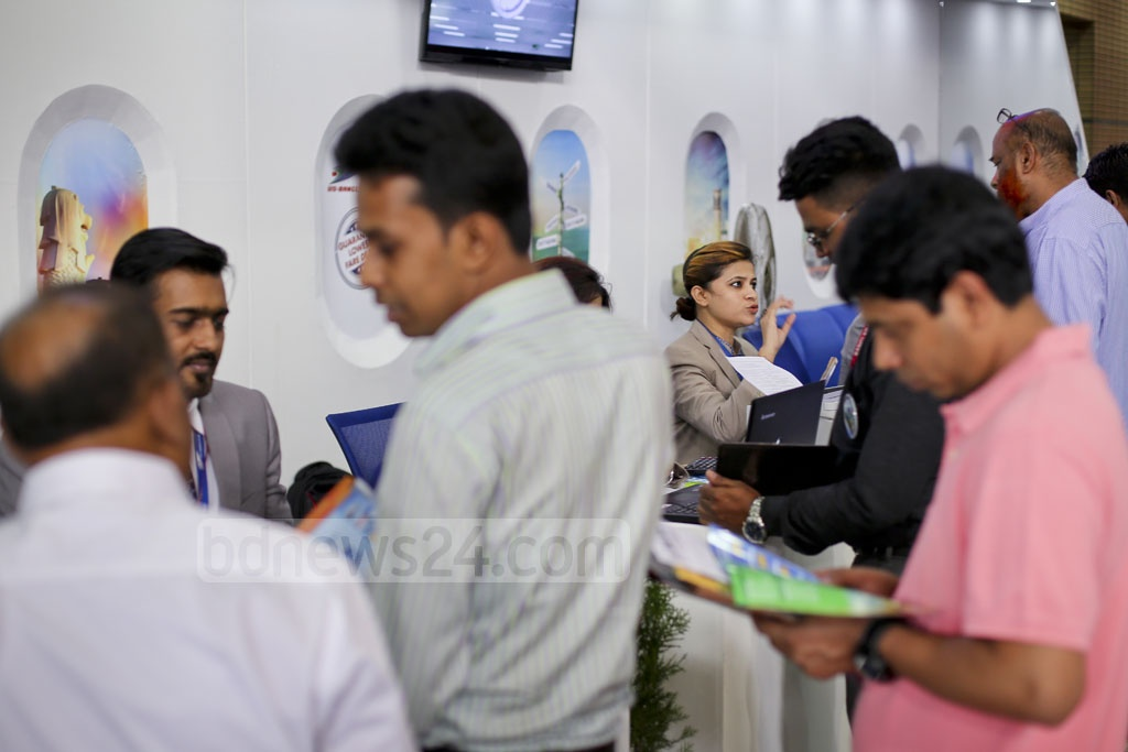 Visitors crowd a stall at the Travel and Tourism Fair at Bangabandhu International Conference Center in Dhaka on Thursday. Photo: asaduzzaman pramanik