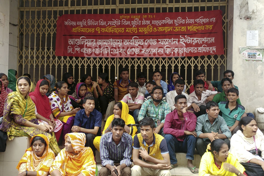 Garment workers from three Ashulia factories block the Department for the Inspection of Factories and Institutions on Thursday to demand back pay and stipends. Photo: abdul mannan