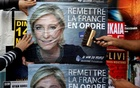 Members of the French National Front (FN) political party paste a poster on a free billboard for the French National Front political party leader Marine Le Pen in Antibes, France, Apr 14, 2017. Reuters