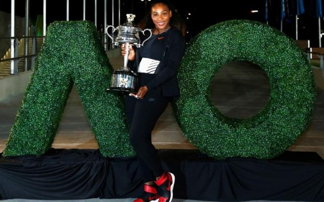Tennis - Australian Open - Melbourne Park, Melbourne, Australia - early 29/1/17 Serena Williams of the US poses with the Women's singles trophy after winning her final match. Reuters