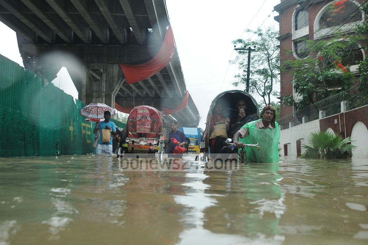 People suffered immensely as the streets in Chittagong City went under water due to heavy rains on Friday. The photo was taken at Gate No. 2 area of Sholoshohor. Photo: suman babu
