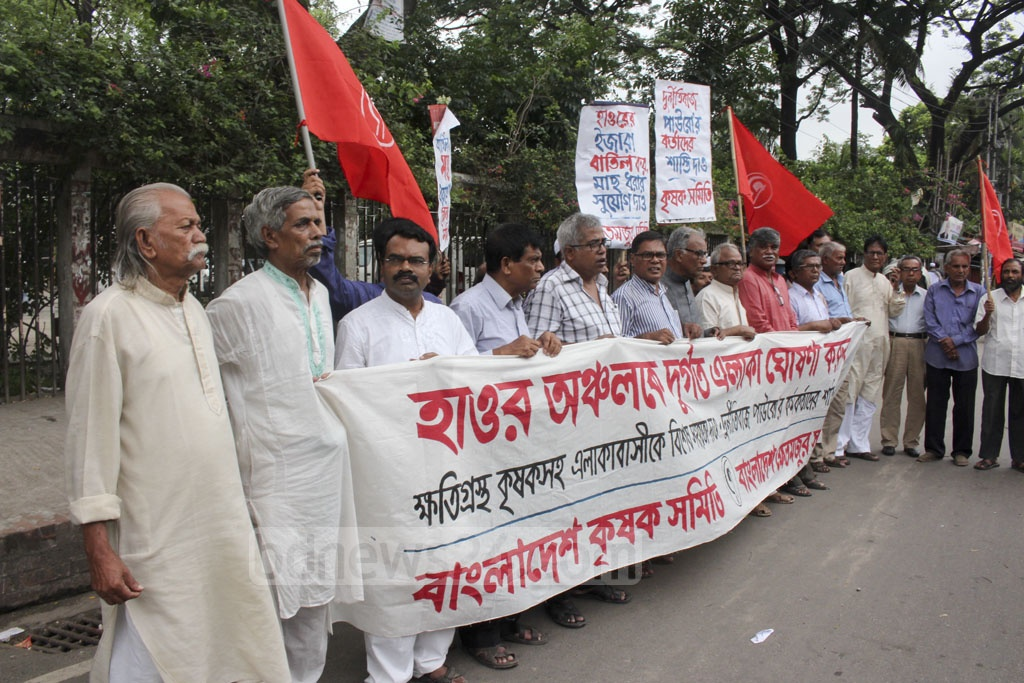 Farmers' associations Bangladesh Krishak Samiti and Bangladesh Khetmajur Samiti demonstrate in front of the National Press Club in Dhaka, demanding special relief for those affected by flood in haor region. They also demand money that the region be declared disaster-hit.