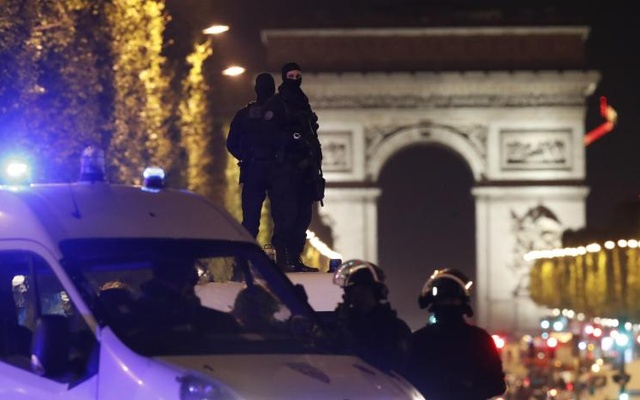 Masked police stand on top of their vehicle on the Champs Elysees Avenue after a shooting incident in Paris, France, April 20, 2017. Reuters