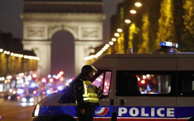 Police secure the Champs Elysees Avenue after one policeman was killed and another wounded in a shooting incident in Paris, France, April 20, 2017. Reuters