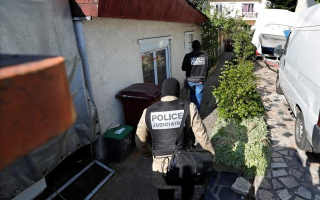 French police arrive at the house of the gunman killed in a shootout with police on the Champs Elysees Avenue, in the Paris suburb of Chelles, France, April 21, 2017. Reuters