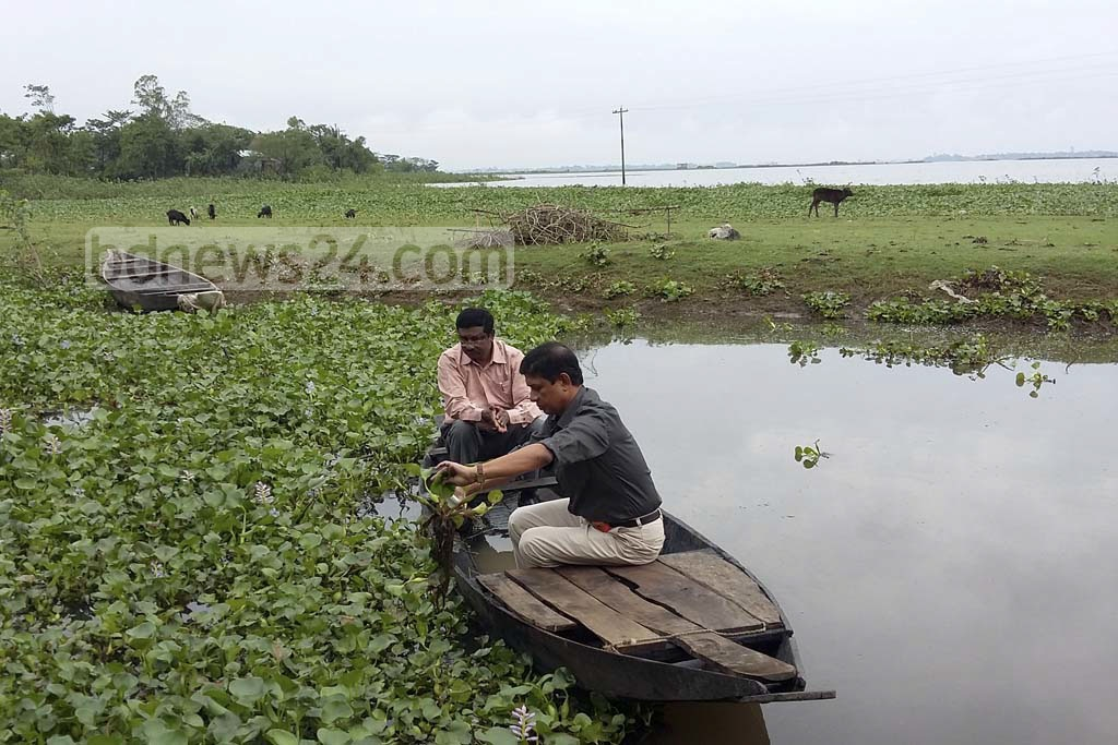 A team of the Bangladesh Atomic Energy Commission (BAEC) measured radiation level at backswamps in the northeastern district of Sunamganj. Photo taken on Sunday from the 'Dekhar Haor' backswamp in Sadar Upazila.