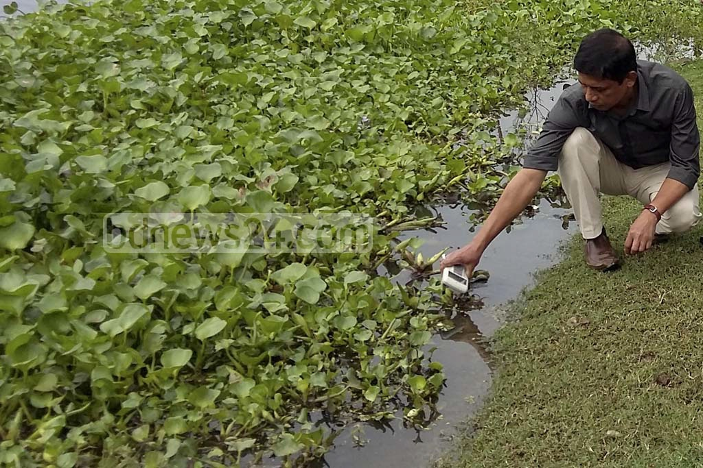 A member of the Bangladesh Atomic Energy Commission (BAEC) team recording radiation level at backswamps in the northeastern district of Sunamganj. Photo taken on Sunday from the 'Dekhar Haor' backswamp in Sadar Upazila.