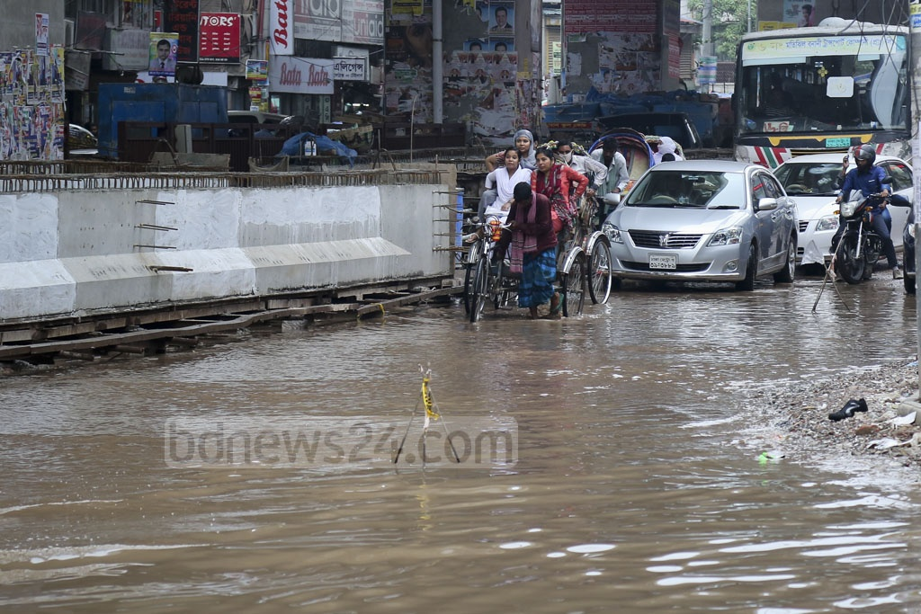 The combination of waterlogging, potholes and pits on roads in the Mouchak area puts commuters at increased risk. Photo: asaduzzaman pramanik