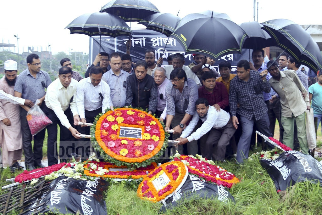 Floral wreaths placed at the graves of Rana Plaza victims. Different organisations and relatives of victims paid tributes at the graves in Dhaka's Jurain on Sunday, the fourth anniversary of the world's deadliest industrial disaster.