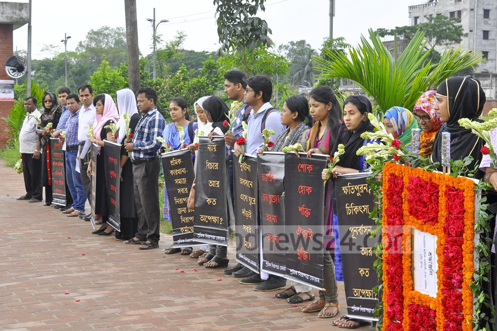 Various organisations demonstrate at Jurain Graveyard in Dhaka, where most of the victims of Rana Plaza collapse were buried, demanding compensation on the fourth anniversary of the disaster on Monday.