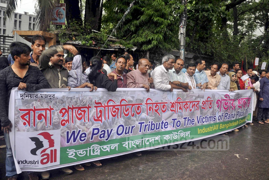 Different organisations form human chains in front of the National Press Club in Dhaka on Sunday to mark the fourth anniversary of the deadly Rana Plaza collapse in 2013.