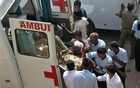 FILE PHOTO: A policeman, who was wounded in a Maoist attack, is moved from an ambulance to a hospital in Jagdalpur, in the eastern Indian state of Chhattisgarh, April 6, 2010. Reuters