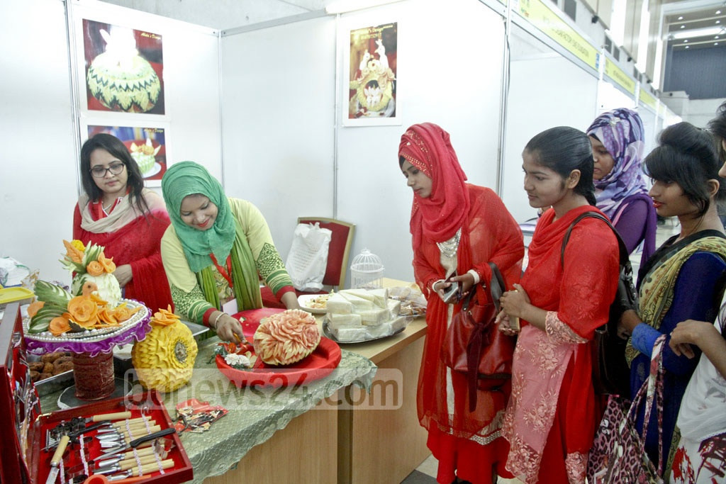 Visitors inspecting products during a tour at the 'Second Food and Agro, Agrocam cum Poultry and Livestock Bangladesh Expo-2017'. Photo: tanvir ahammed
