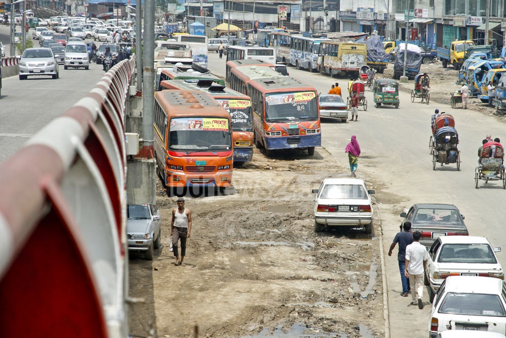 Space adjacent to Kuril Flyover gradually becoming a permanent parking space for the vehicles used as public transport in the city. In most cases drivers parked their vehicles in a haphazard manner creating congestation in the area. The photo was taken on Wednesday. Photo: tanvir ahammed