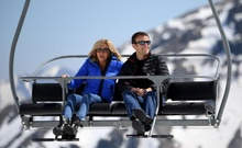 Emmanuel Macron, head of the political movement En Marche ! (Onwards !) and candidate for the 2017 presidential election, and his wife Brigitte Trogneux sit on a chairlift on their way to the mountain top for a lunch break during a campaign visit in Bagneres de Bigorre, in the Pyrenees mountain, France, April 12, 2017. Reuters