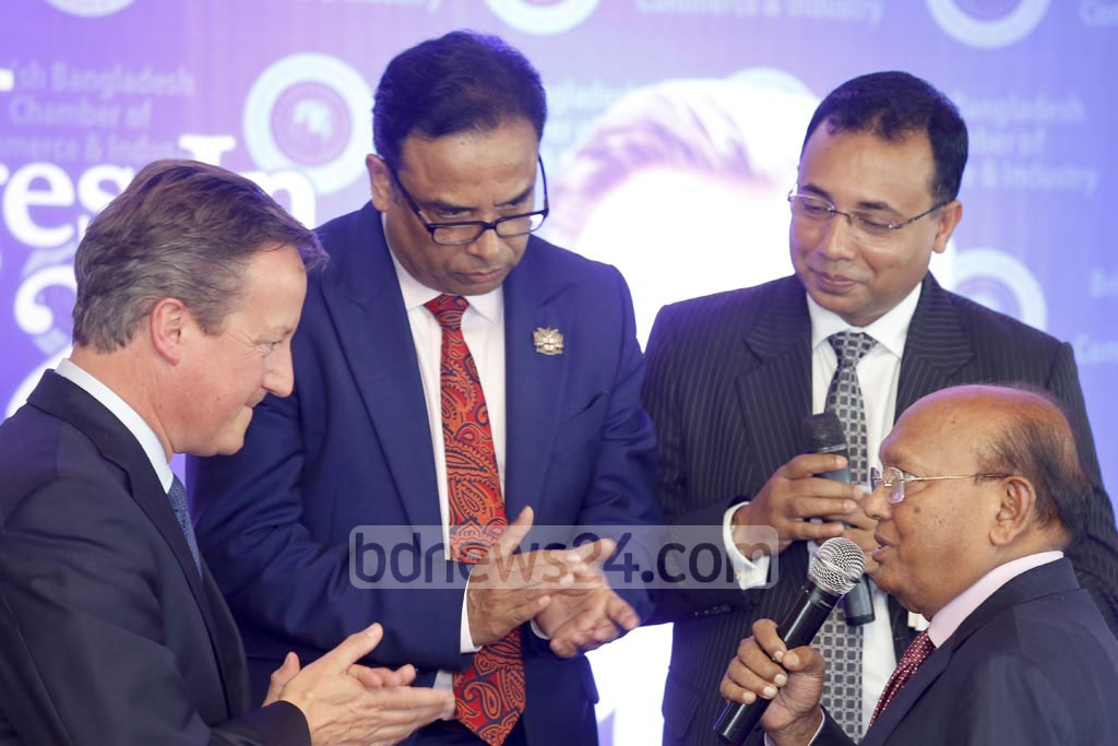 Commerce Minister Tofail Ahmed interacts with former British prime minister David Cameron at the discussion 'Global Challenges 2017' at a Gulshan hotel on Thursday. Photo: mostafigur rahman