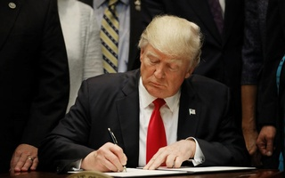 US President Donald Trump signs an executive order on education as he participates in a federalism event with Governors at the White House in Washington, DC, US, April 26, 2017. Reuters