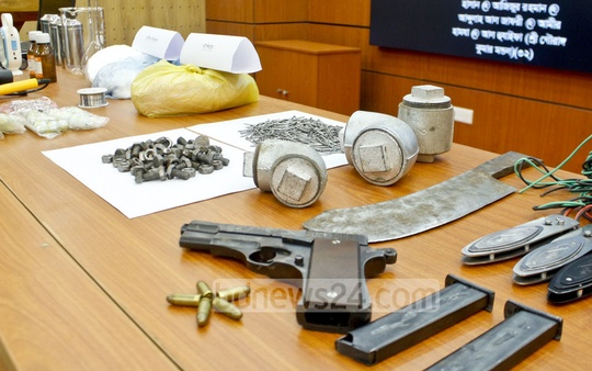 The Rapid Action Battalion displays firearms, ammunition, knives and bomb-making materials at its media centre in Dhaka after finding them on three militant suspects arrested from a bus in Savar.