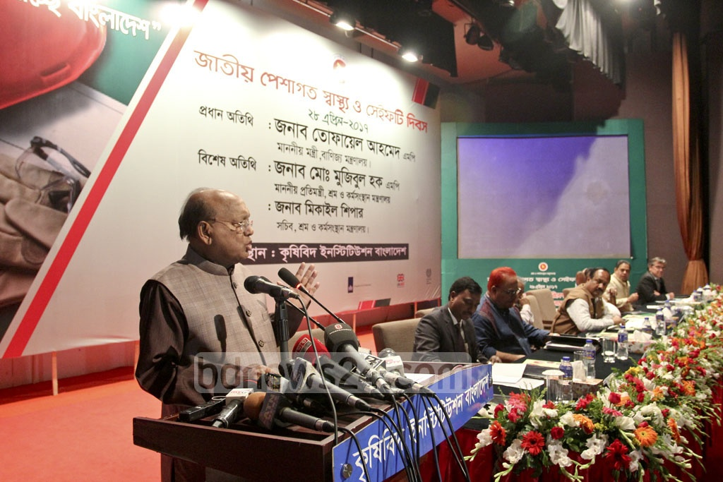 Commerce Minister Tofail Ahmed speaks at a National Occupational Health and Safety Day programme at Dhaka's Krishibid Institution Auditorium on Friday. Photo: asif mahmud ove