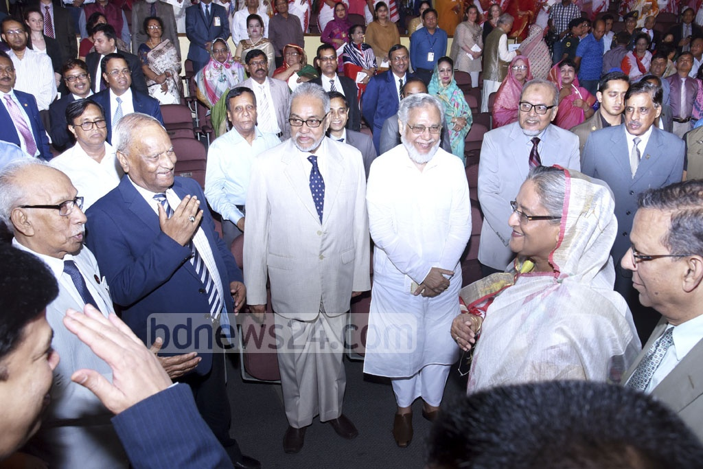 Prime MInister Sheikh Hasina exchanges greetings with judges and lawyers at the inauguration of National Legal Aid Day at Osmani Memorial Auditorium in the capital on Friday. Photo: Saiful Islam Kallol