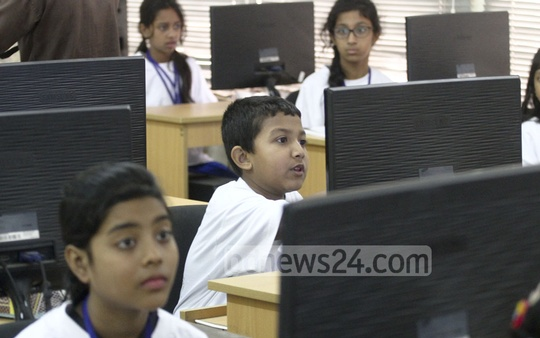 Participants are engrossed in coding in the final competition of National Children's Coding Fest-2017 in at Dhaka University's computer science and technology department lab on Friday. Photo: abdul mannan