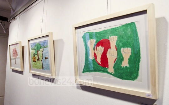 Art by underprivileged children is displayed at Dhaka's Drik Gallery during an event organised by Switch Vidya Niketan on Saturday. Photo: asif mahmud ove