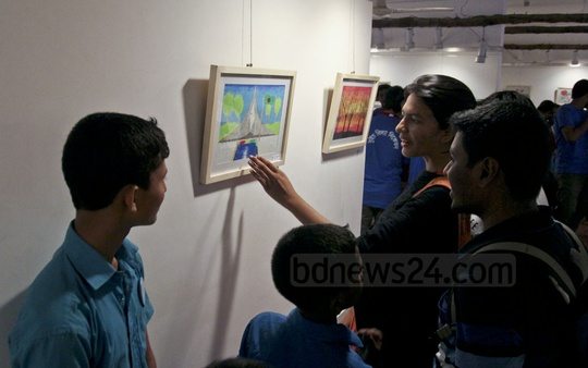 Visitors view an exhibition of art by underprivileged children at Dhaka's Drik Gallery on Saturday. Photo: asif mahmud ove