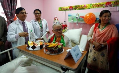Taiwanese hiker Liang Sheng Yueh, who was lost in the Himalayas for over a month, celebrates his 21st birthday at a hospital after being rescued, in Kathmandu, Nepal Apr 28, 2017. Reuters
