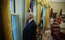 US President Donald Trump looks out a window of the Oval Office following an interview with Reuters at the White House in Washington, US, April 27, 2017. Reuters