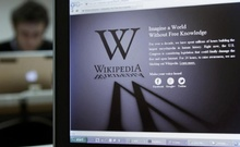 File photo: A reporter's laptop shows the Wikipedia blacked out opening page in Brussels Jan 18, 2012. Reuters
