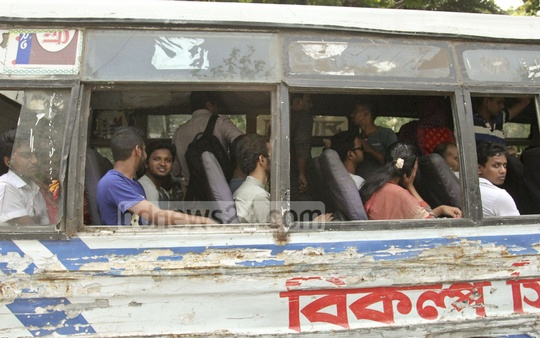 A run-down bus with very few window panes is seen making routes during the rainy season as transport owners continue to neglect the interest of passengers. Photo: asif mahmud ove