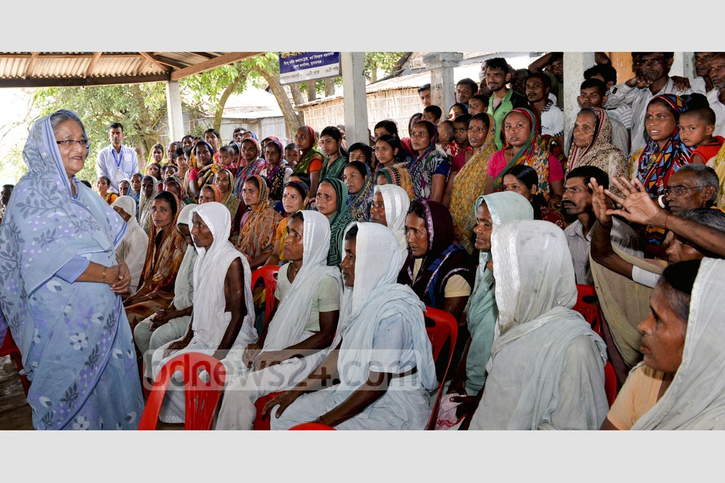 Prime Minister Sheikh Hasina spoke to a goup of flood-affected people of Haor areas to know about their predicaments at the Shaheed Ali High School at Shalla Upazila in Sunamgamj on Sunday. Photo: PID