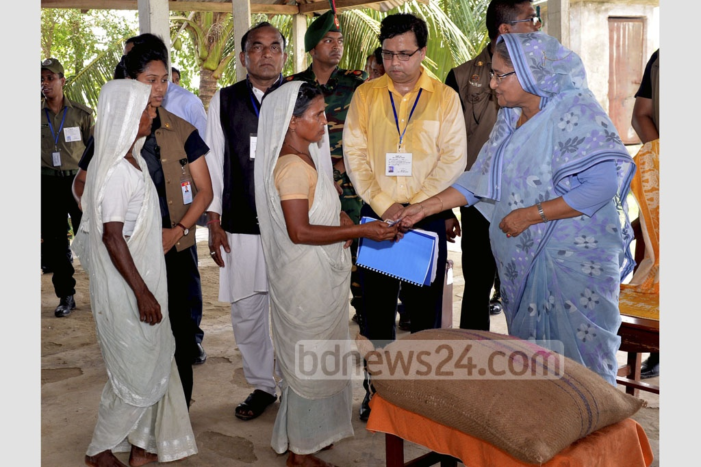 Prime Minister Sheikh Hasina distributed relief materials among the flood-affected people of Haor areas at the Shaheed Ali High School at Shalla Upazila in Sunamgamj on Sunday. Photo: PID