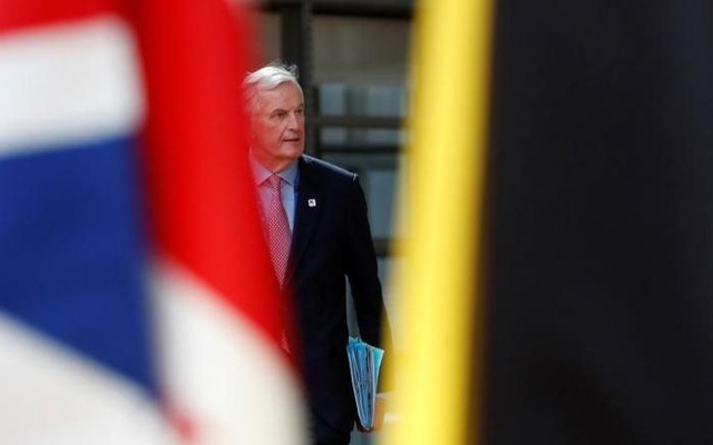 European Chief Negotiator for Brexit Michel Barnier walks past the Union Jack flag as he arrives at the EU summit in Brussels, Belgium, April 29, 2017. Reuters
