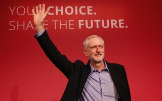 The new leader of Britain's opposition Labour Party Jeremy Corbyn waves after making his inaugural speech at the Queen Elizabeth Centre in central London, Sept 12, 2015. Reuters