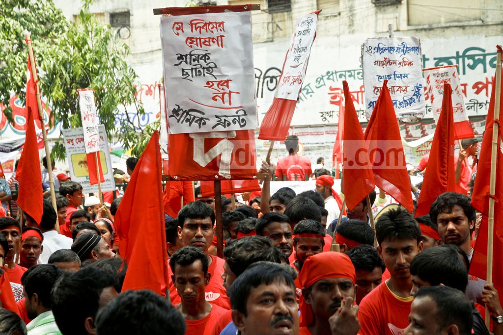 Workers rally in Dhaka on Monday to mark May Day with calls for a Tk 15,000 minimum monthly salary and safe working conditions. Photo: tanvir ahammed