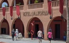 Tourists walk past Hotel California in the town of Todos Santos, Baja California Sur, Mexico, May 2, 2017. Reuters