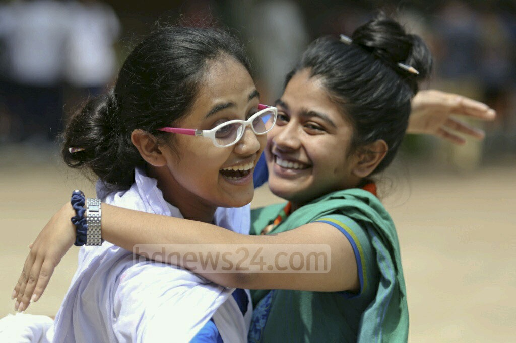 Two students of Dhaka's Motijheel Ideal School embrace each other on doing well in SSC on Thursday. Photo: asaduzzaman pramanik
