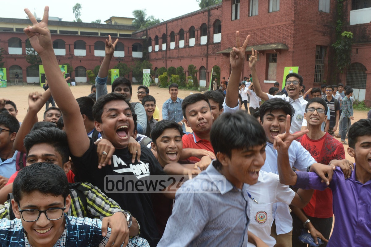 Students of Chittagong's Collegiate School flash victory sign after doing well in the SSC exams published on Thursday. Photo: suman babu