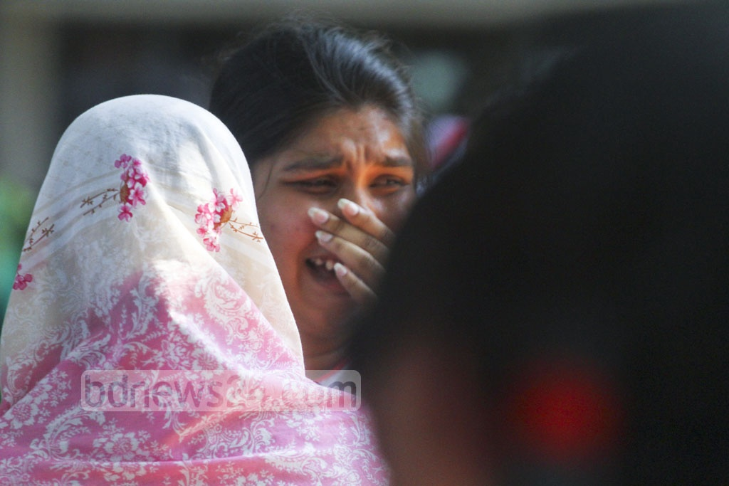 A student at Holy Cross School and College in Dhaka breaks down in tears after finding her SSC test results unsatisfactory on Thursday. Photo: abdul mannan