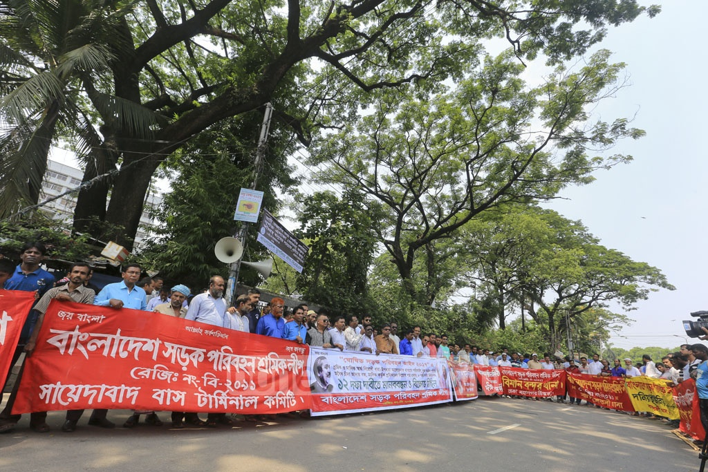 Bangladesh Road Transport Workers' League demonstrates in front of the National Press Club on Friday for a 12-point charter of demand. Photo: asaduzzaman pramanik