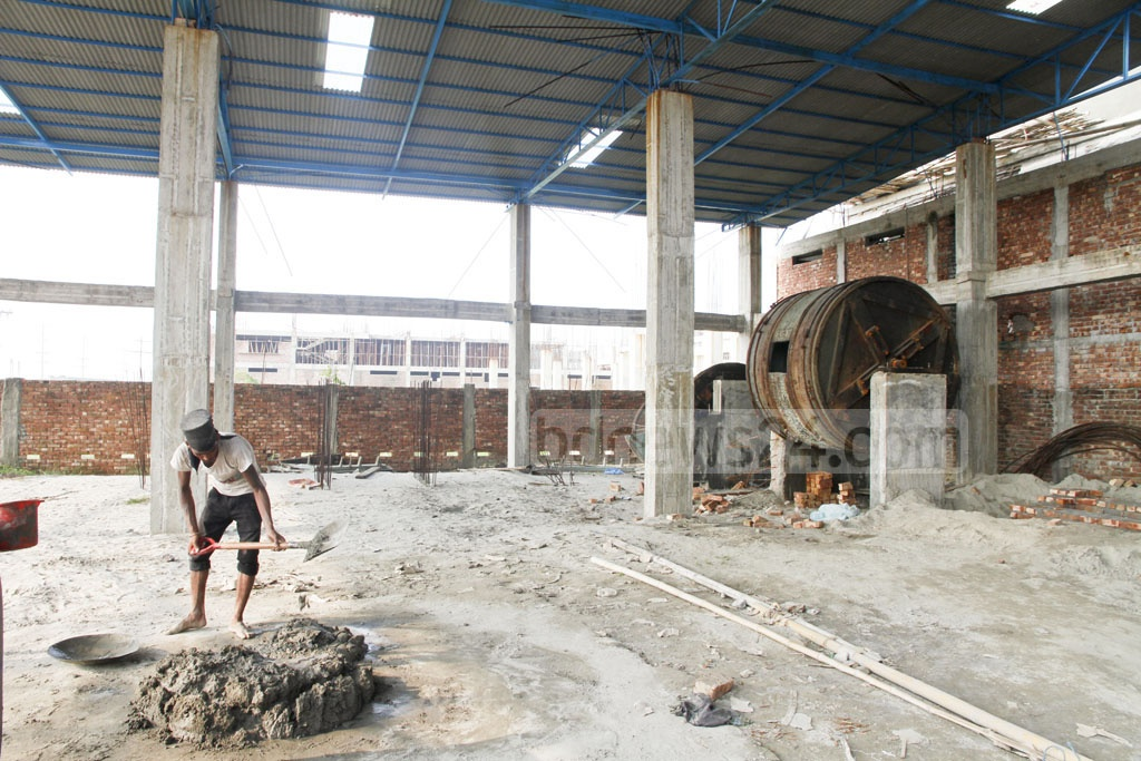 Machineries from Hazaribagh tanneries are left on the ground as the complex for factory is yet to be set up. The photo was taken at the leather industrial city in Savar's Hemayetpur on Saturday. Photo: tanvir ahammed