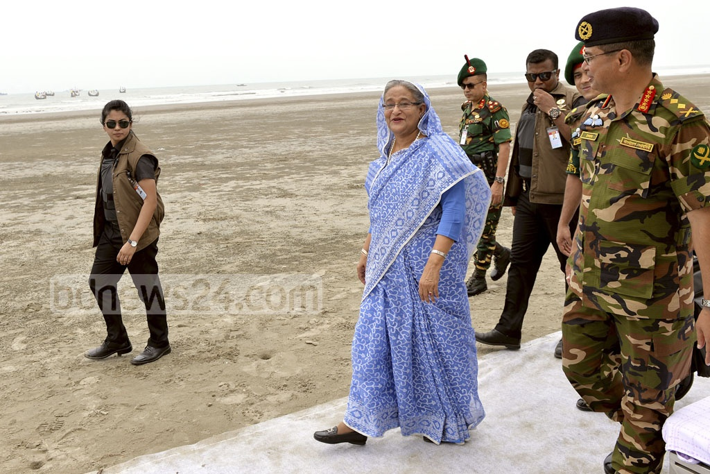 Prime Minister Sheikh Hasina takes a stroll along Inani beach on Saturday after inaugurating a marine drive connecting Cox's Bazar and Teknaf.