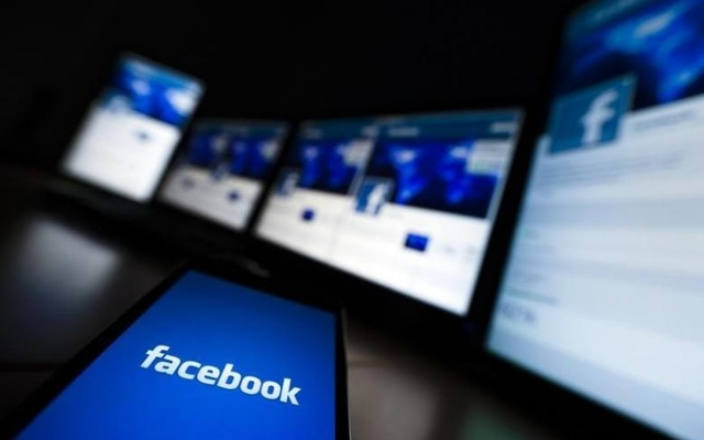 The loading screen of the Facebook application on a mobile phone is seen in this photo illustration taken in Lavigny May 16, 2012. Reuters