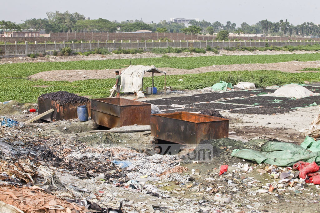 Boiled tannery waste is set out to dry. The dried waste is then crushed to produce chicken feed. Photo: tanvir ahammed